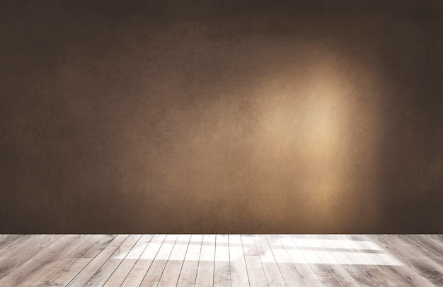 Brown wall in an empty room with a wooden floor