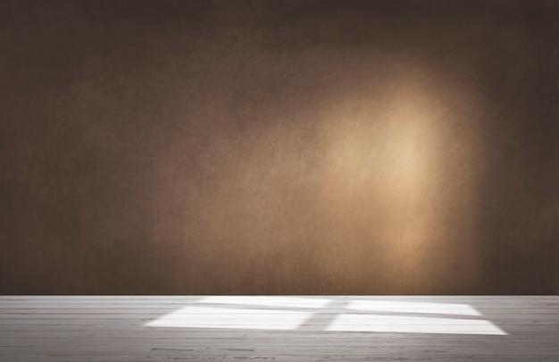 Коричневая стена в пустой комнате с бетонным полом