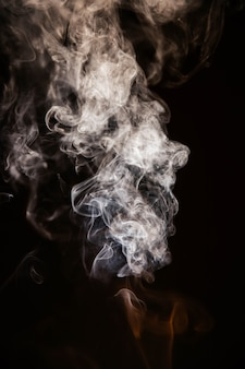 Brown wavy smoke on black background