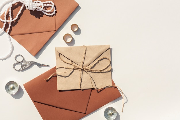 Brown wedding envelopes on white background with copy space