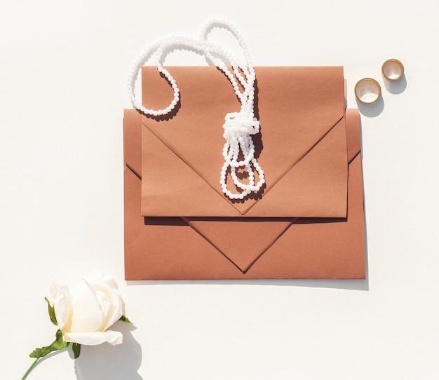 Brown wedding envelopes on white background