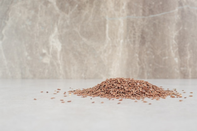 Brown wheat grains isolated on concrete.