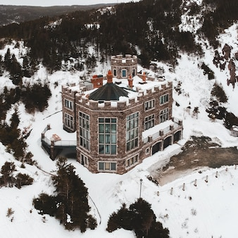 Brown and white house on snow covered ground