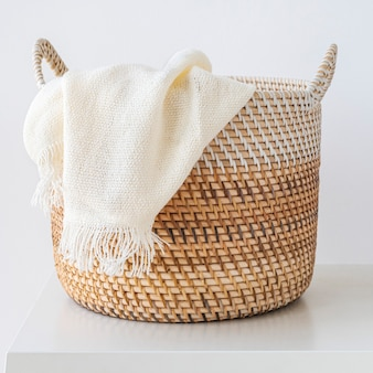 Brown wicker laundry basket design element