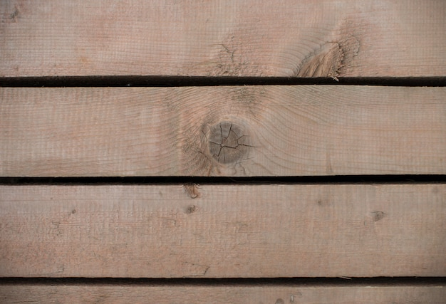 Brown wood boards with holes between them  texture. space for design