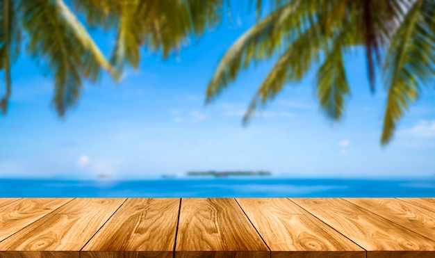 Brown wood table on summer tropical beach.