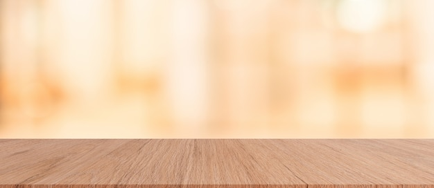 Brown wood tabletop with blurred restaurant bar cafe light color background f