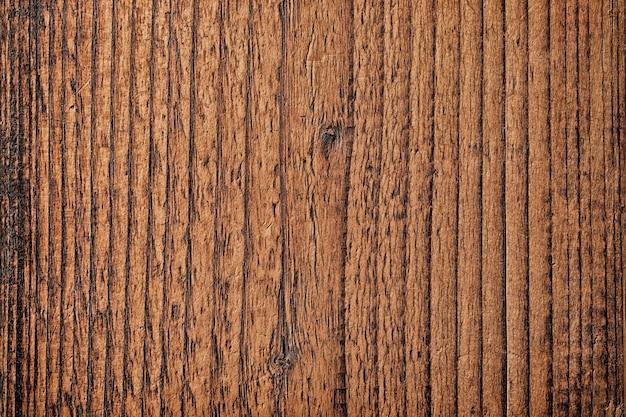 Текстура коричневого дерева с естественным рисунком, темная доска