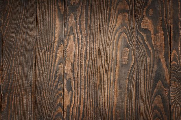 茶色の木製の背景まな板