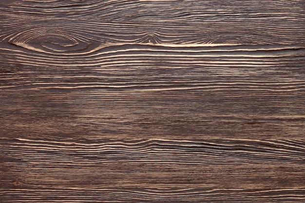 Текстура коричневой деревянной доски. вид сверху, плоская планировка