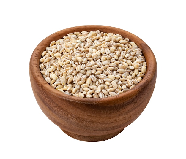 Brown wooden bowl with dried pearl barley