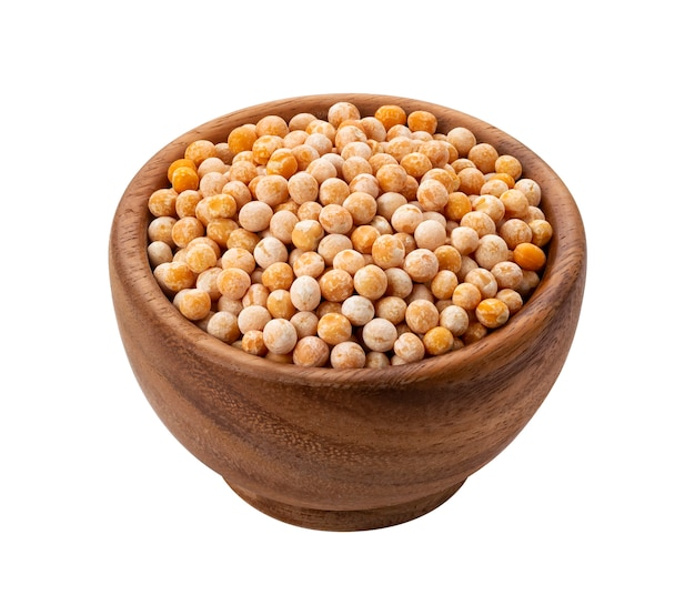 Brown wooden bowl with dried yellow pea