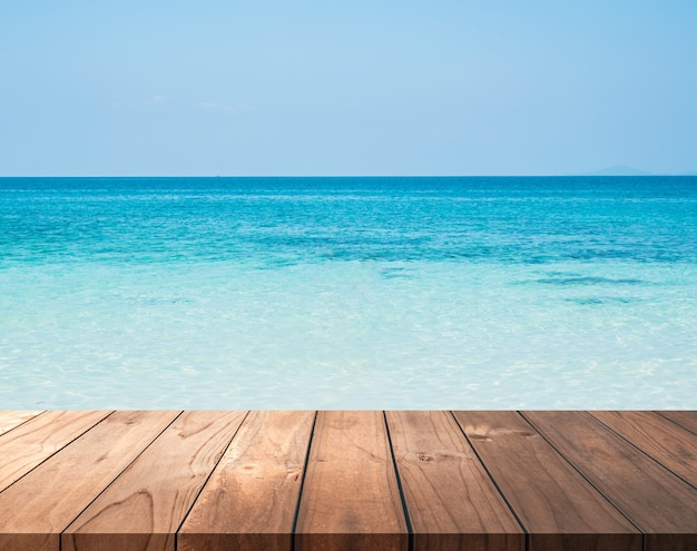 Brown wooden floor with blue sea backgrounds for display products