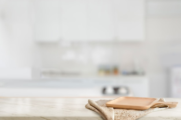 Brown wooden plate on marble counter table top in kitchen room