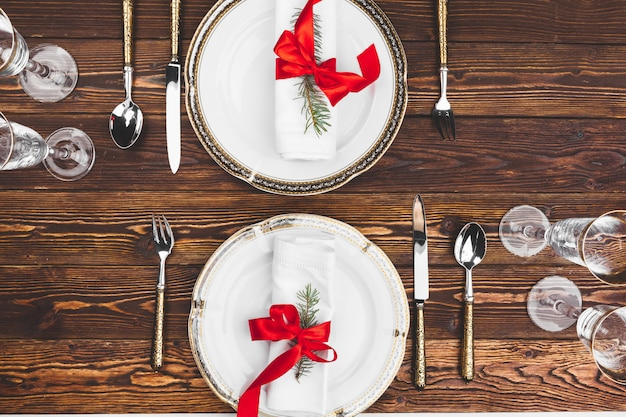 Brown wooden table with beautiful christmas table setting
