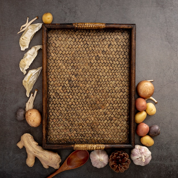 Brown wooden table with spices on a grey background
