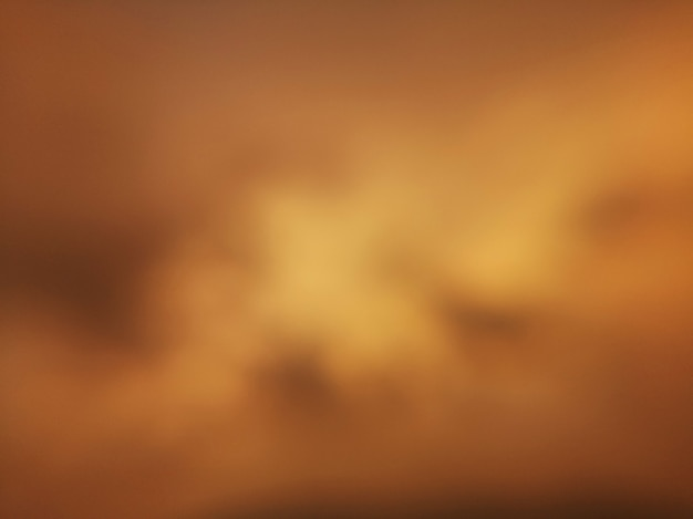 Brown yellow gold blurred abstract wallpaper background