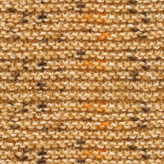 Brown yellow knitted fabric seamless pattern
