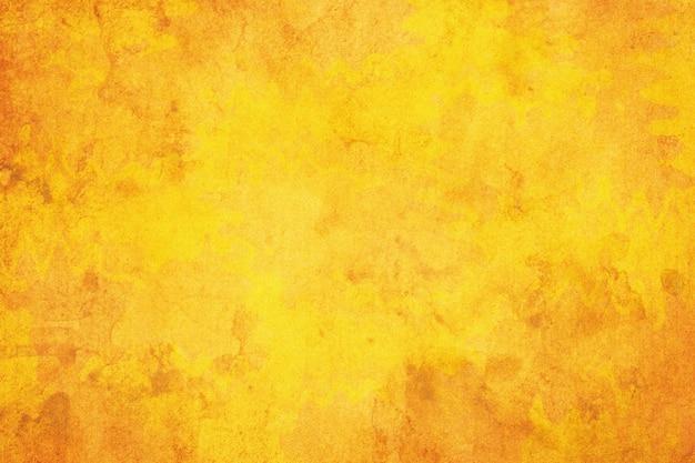 茶色の黄色い紙のグランジ背景。