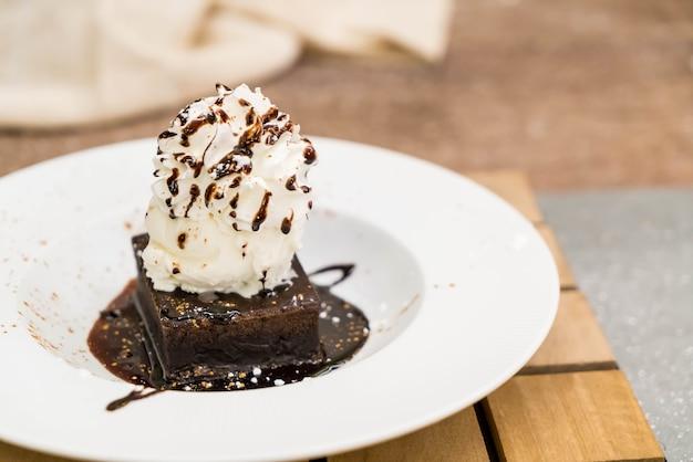 Brownie sundae with a scoop of vanilla ice cream