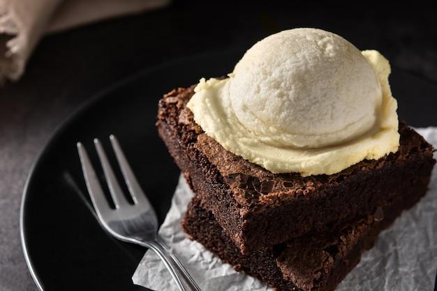 Brownie with vanilla ice cream scoop