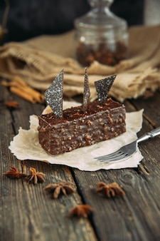 Brownie on wooden table with fork. country style