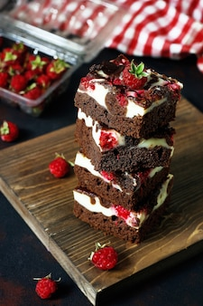 Brownies tower with cottage cheesecake and raspberries