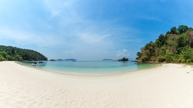 Bruer island, amazing island from southern of myanmar. a stunning seascape with turquoise water and sand beach against blue sky at bruer island. panoramic view