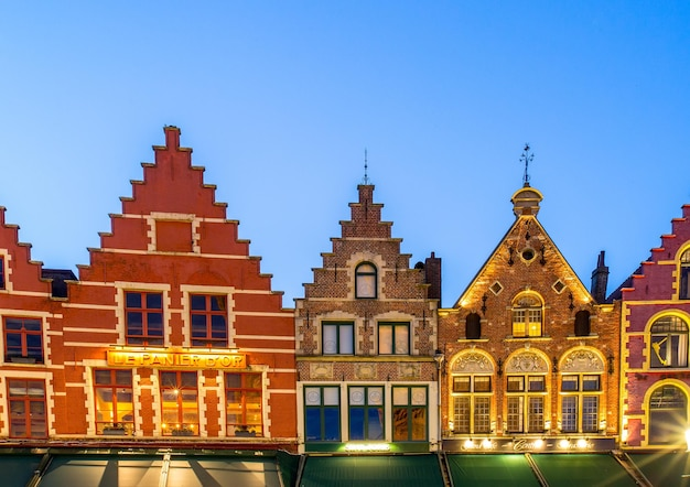Bruges,belgium-april 26 ,2017: market square old and heritage house where tourist people come to visit in bruges ,belgium.