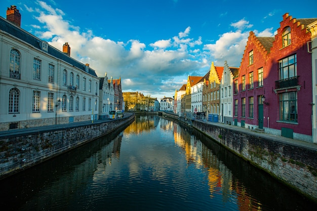 Bruges canals cityscape with blue sky.