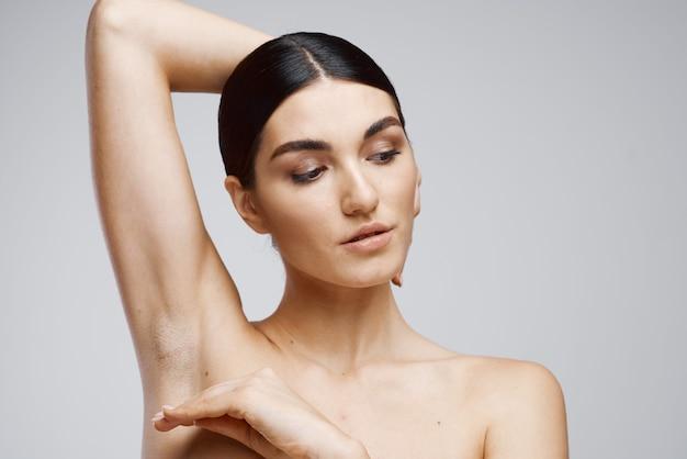 Brunette bare shoulders clear skin depilation care. high quality photo