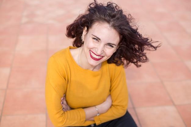 Brunette blogger posing for a photo