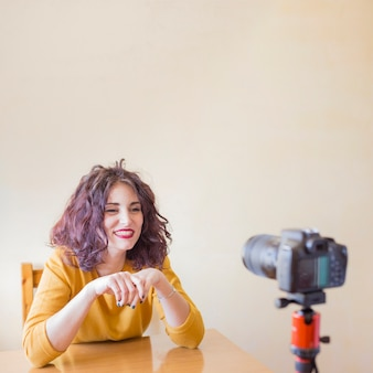 Brunette blogger recording a video