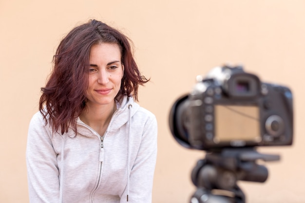 Brunette blogger recording a video