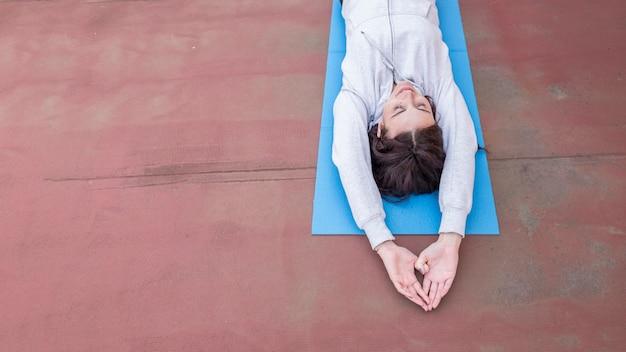 Brunette blogger recording yoga routine