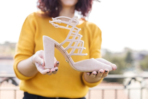 Brunette blogger showing heel to the camera