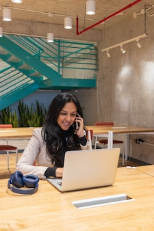 Brunette business woman working from her workspace
