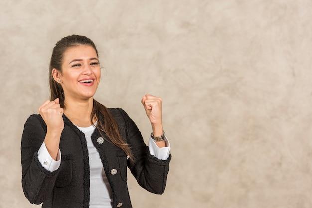 Brunette businesswoman celebrating