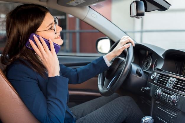 Brunette businesswoman driving