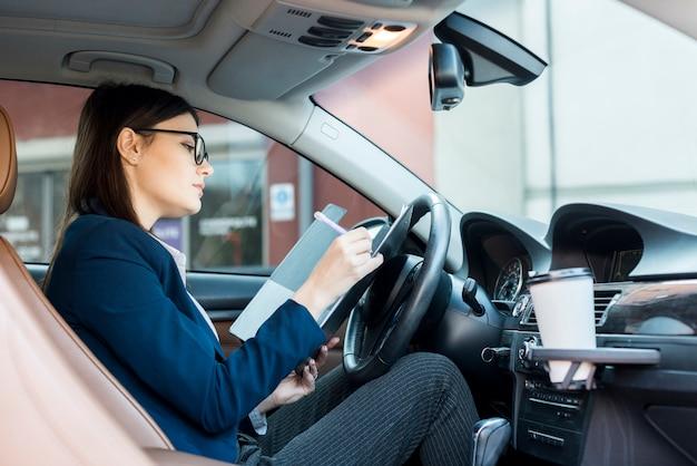 Brunette businesswoman inside a car