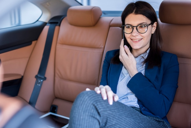 Brunette businesswoman inside a car