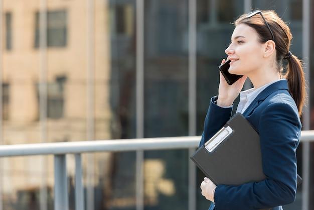 Brunette businesswoman outdoors