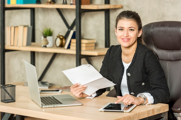 Brunette businesswoman posing