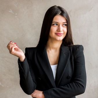 Brunette businesswoman posing