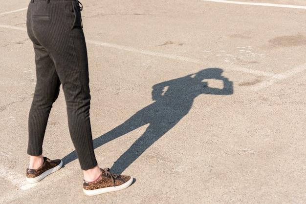 Brunette businesswoman shadow outdoors