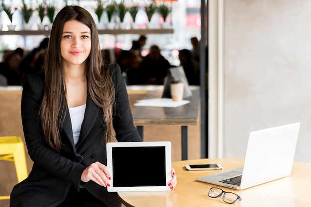Brunette businesswoman showing her tablet