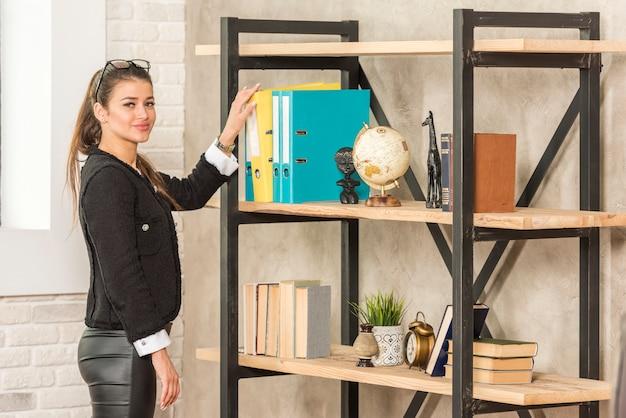 Brunette businesswoman taking folder