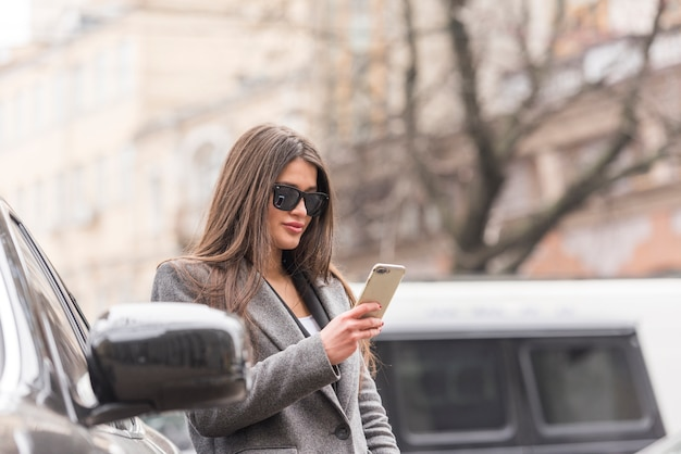 Brunette businesswoman using her smartphone