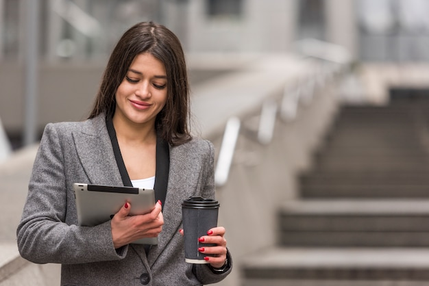 Brunette businesswoman using her tablet