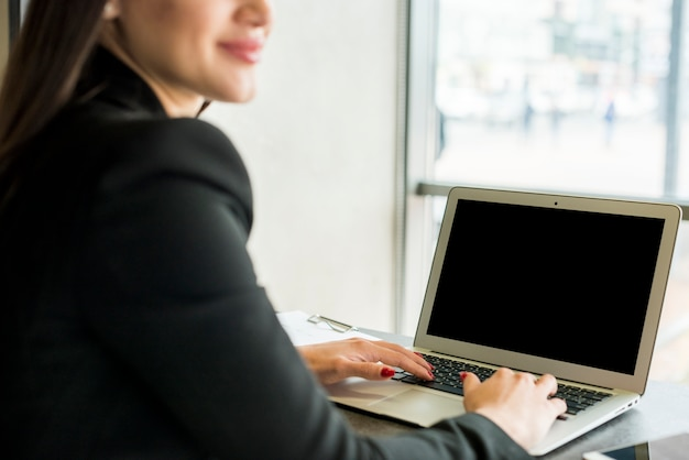 Brunette businesswoman using laptop